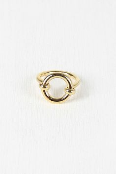 """Open Circle Hardware Ring. This cute  ring  features a cut out circle design with a high polish metal band. Non-adjustable.Measurement Measures approx. 0.75"""" D"""