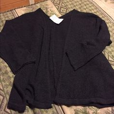 Brandy Melville black Caroline cardigan Brand new Brandy Melville black Caroline cardigan • 2 available • no trades Brandy Melville Sweaters Cardigans