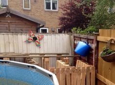 Pallets used as framework for raised pool decking