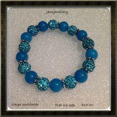 Stunning sparkle from Swarovski Crystals with blue Quartzite Gemstones Bracelet.