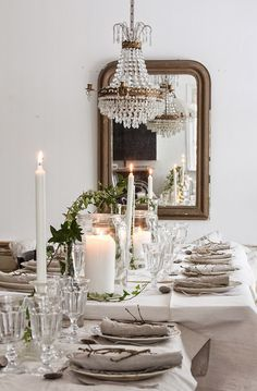 Vintage House: TJEJKVÄLL   elegant holiday table decor   love the simplicity of this! Gorgeous crystal chandelier and candle light #white on white #Christmasdecor