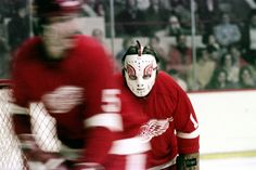 Jim Rutherford's Red Wing goalie mask, with Jean Hamel in foreground. 1974