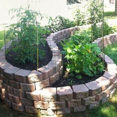 """Beautiful curved raised bed garden using Landscape """"Stones."""" You can buy these cut to allow you to make curves at both Home Depot & Lowes.:"""