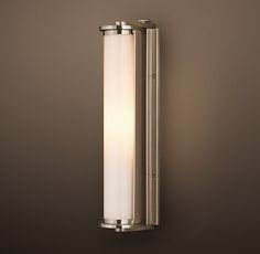 RH's Royale Adjustable Sconce:A circa-1940s light salvaged from a ship inspired our sconce, a streamlined design sized to illuminate smaller spaces or to deploy in multiples for larger ones.