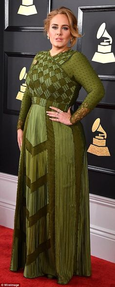 59th annual Grammy Awards 2017 Flawless: The 28-year-old songstress ADELE wowed in the figure-hugging olive green Givenchy Haut...