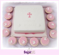"""First Holy Communion cake and butterfly cupcakes. 10"""" vanilla sponge."""