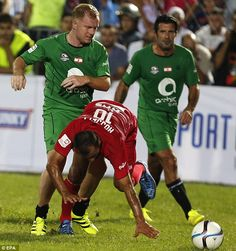 Paul Scholes pictured fighting for the ball during the Game of Legends friendly…