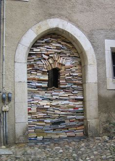 Book window - Jan Reymond book installation for the Romainmôtier annual used book fair