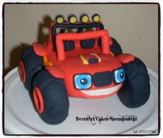 Gum paste Blaze Monster Truck Connect with me on Facebook.www.facebook.com/SweetArtCakesBfn/  For more info email SweetArtbfn@gmail.com or call 0712127786 Edible Cake, Gum Paste, Cupcake Toppers, Minions, Fondant, Icing, Cake Decorating, Monster Trucks, Cooking Recipes