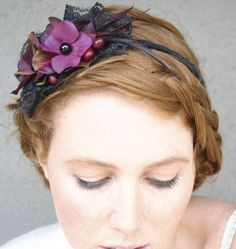 Have a little fun with this black lace and plum flower headband, with black beads ans a few berries