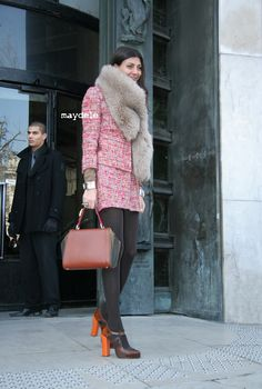 giovanna battaglia knows how to set off a mini skirt - tights, sky high heels + a statement around her neck