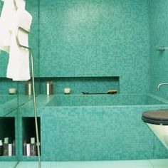 Spa-style turquoise mosaic bathroom tiles.   For a touch of spa-style at home, aqua blue mosaic tiles are ideal. For a tile effect like this the walls need to be perfectly flat and even, make sure you consult a tiling expert before attempting a job like this yourself.