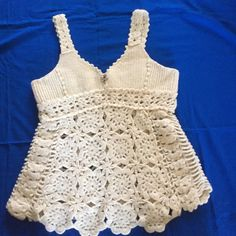 Knitted Top Super cute knitted tank top. I purchased this from another posher and it didn't fit me so I'm posting it looks like new it's in great condition. Dollie Tops Tank Tops