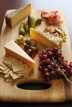 Gourmet Game Day Cheese Platter. Pair SarVecchio® Parmesan, Black Pepper BellaVitano® and Rosemary & Olive Oil Asiago with mixed nuts, prosciutto, juicy red grapes, multi-grain crackers, pickles and an olive medley.