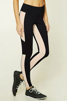 A pair of stretch-knit athletic leggings featuring contrast panels, a hidden key pocket, and moisture management.