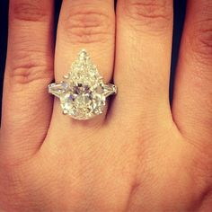 Stunning! This pear engagement ring is certainly a show stopper! What do you think of this #diamond shape? #engagementrings #pear #allaboutdiamonds #diamondmonth #sparkle #platinum