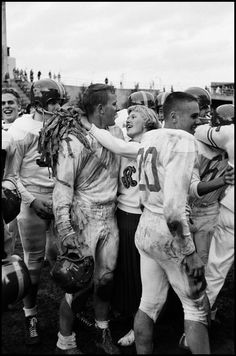 Burt Glinn High School Football Seattle, 1955, the head cheerleader and the captain of the football team embrace after a game.