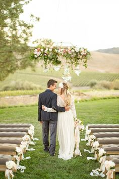 Elegant Winery Wedding Ceremony with a Floral Chandelier | Mike Larson Photography on @heyweddinglady via @aislesociety