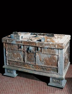 Strongbox, Oplontis  This unique piece was found in the peristyle of the Villa of Lucius Crassius Tertius. The wooden framework of the box is covered by iron leaves, and is inscribed with the names of three characters, possibly the artisans who created the box: Pytonymos, Pyteas, and Nicocrates.