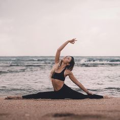 @alliemichellel reaching for the starts in our #SpiritualGangster Stars Paradise Yoga Sports Bra | Available at YogaOutlet.com