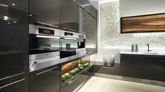 Love the black gloss cupboards.