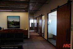 CFT-202-BP Sliding Door Kit is used here in an office building in Calgary, Alberta to create a rich and streamlined look and feel