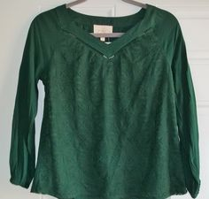 "November 2015 Stitch Fix. Skies are Blue Burton Lace Overlay Top in Emerald Green. The shell is 100% Rayon, the overlay is a Cotton/Nylon blend. This is a ""petite"" with a length of 23"". https://www.stitchfix.com/referral/4292370"