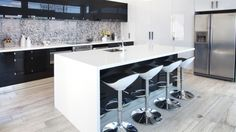 This kitchen has the 'wow' factor! The crisp black and white kitchen with Corian countertops and high gloss acrylic cabinetry Corian Countertops, Two Tone Kitchen, Kitchen Gallery, Wow Products, Table, Furniture, Home Decor, Two Toned Kitchen, Decoration Home