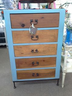 """SOLD - This is a rustic style 5 drawer chest  that sits on a metal base with metal legs. the chest has been painted turquoise and distressed with natural drawer fronts. Measures approximately 30"""" by 18"""" by 48"""". It can be seen in Booth C1 at Main Street Antique Mall, 7260 E Main St (E of Power) Mesa, AZ 85207 - 480-924-1122 - Open 7 days a week 10a.m. to 5:30p.m. - Cash, Charge or 30 day layaway available."""