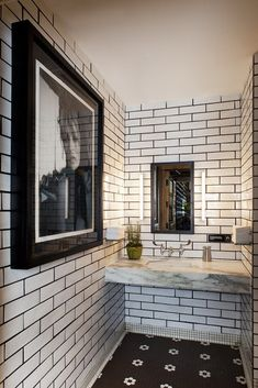 Subway tile + dark grout + marble slab vanity.