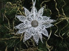 White Lace Snowflake Ornament Christmas Tree Ornament with Silver Button Center U-Pick button. via Etsy.