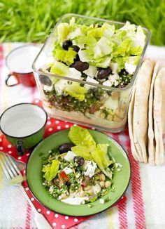 Swap a sarnie for this filling salad. Packed with chickpeas, pulses and garnished with a zesty dressing. Serve with flat bread as an optional extra.