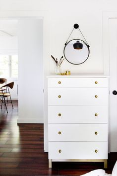 #ikea TARVA chest of drawers: painted white, legs trimmed and painted gold, #menards knobs added