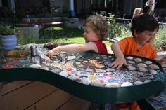 A mosaic water table designed by Earthplay. Love. Love. Love.