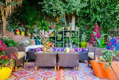 """Justina's L.A. front yard overflows with lush greenery, fanciful blooms, and kaleidoscopic colors, patterns, and textures to perfectly reflect her """"jungalow"""" vibe. It's her family's outdoor living room, where they regularly hang out and entertain friends."""