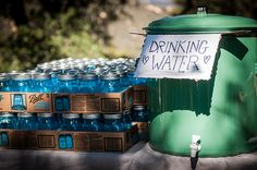 Photo by Purple Turtle Photography. Holly & Darin's Campground wedding. Drinking Station.