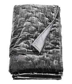 Dark gray. King/queen bedspread with a velvet front, woven cotton backing, and polyester fill.