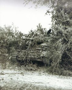 "fallschirmjager: "" Panzerkampfwagen IV Ausf. ""J"" belonging to 2nd SS-Panzer Division ""Das Reich"" is waiting to support these Fallschirmjäger a few dozen yards down the road. Saint Lô, France 4.7.1944. On both sides it was the same way of fighting; a..."