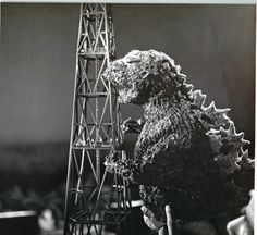 Godzilla puppet attacks scale model tower in GODZILLA (1954)