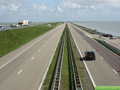The Afsluitdijk (English: Enclosure Dam) is a major causeway in the Netherlands, constructed between 1927 and 1933 and running from Den Oever on Wieringen in North Holland province, to the village of Zurich in Friesland province, over a length of 32 kilometres (20 mi) and a width of 90 m, at an initial height of 7.25 m above sea-level.