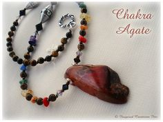 WOW CHAKRA RAINBOW: Stunning red Agate center piece surrounded by chakra colored semi precious stone, sterling silver Bali beads as well as Onyx and Tiger's Eye. This is an all-around balanced piece that will not only align your energy centers but look absolutely amazing too!