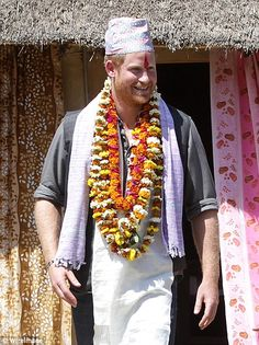 Prince Harry donned local headgear and was greeted by a second group of ceremonial virgins on day three of his tour of Nepal