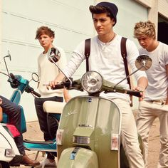 Imagine touring Europe on Vespas with them