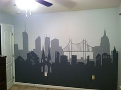 Batman bedroom I painted for son using clipart silhouettes, painters tape and a craft projector.  I made it Manhattan-ish too in case he outgrows Batman and wants a NY Yankees bedroom instead