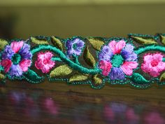 Multicolour Embroidered designer Floral Lace and Trims, Indian lace, border (Width- 1.5 inches).This stunning lace can be used for designing stylish blouses, shrugs, skirts, tunics, festive wear,...