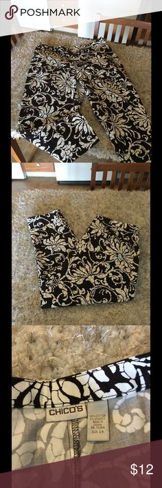 Chico's Floral Capris Size 14 Chico's Floral Capris. Dark brown with white.  Side zipper closure. Chico's, size 2.5. Which converts to a size 14.  Inseam is 24.5 inches long.   Excellent condition.   Important:   All items are freshly laundered as applicable prior to shipping (new items and shoes excluded).  Not all my items are from pet/smoke free homes.  Price is reduced to reflect this!   Thank you for looking! Chico's Pants Capris