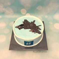 """F35 jet plane 2d chocolate topper on 8"""" chocolate truffle whipcream cake for a 65thbirthday"""