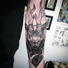 Abstract Male Deer Tattoos On Outer Forearm