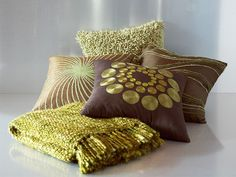 Give a boost to your living room with the Mara pillow and throw pack.
