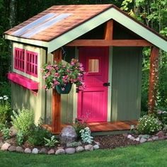 Garden playhouse for the children or grandchildren and the little flowerbed is a great idea so the kids can plant there own flowers.